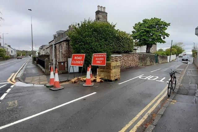 Planters have been introduced to calm traffic and congestion at school gates.