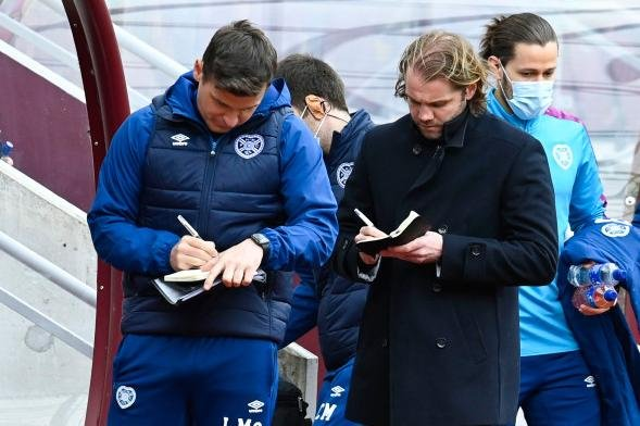 Robbie Neilson (right) has come under criticism from Hearts fans over recent results. (Photo by Rob Casey / SNS Group)
