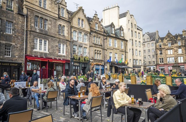 Continental-style outdoor eating and drinking areas have become an increasingly common sight in Edinburgh - seen here in the Grassmarket. Picture: Jane Barlow/PA Wire
