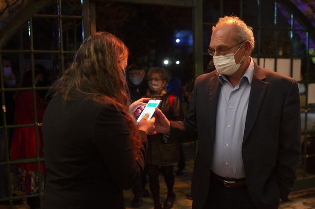 A man presents his 'green passport', proof that he has been vaccinated against the Covid-19 coronavirus at a theatre in Jerusalem. The idea is being considered in the UK (Picture: Maya Alleruzzo/AP)