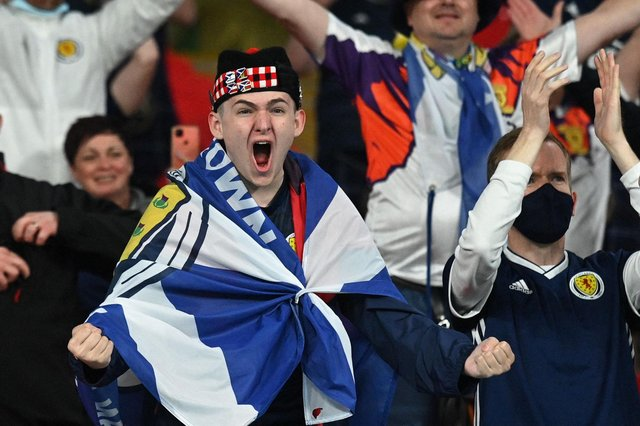 Scotland fans react after the UEFA EURO 2020 Group D football match between England and Scotland at Wembley Stadium in London on June 18, 2021. (Photo by JUSTIN TALLIS / POOL / AFP) (Photo by JUSTIN TALLIS/POOL/AFP via Getty Images)