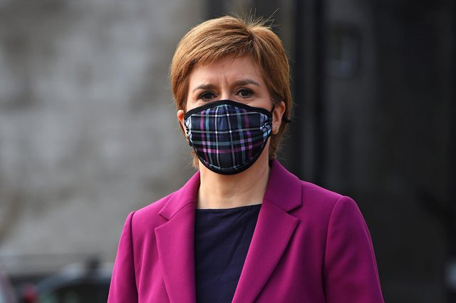 Nicola Sturgeon wearing a protective face covering while campaigning with Edinburgh Western candidate Sarah Masson on April 20 in South Queensferry, Scotland (Photo by Andy Buchanan - Pool/Getty Images).