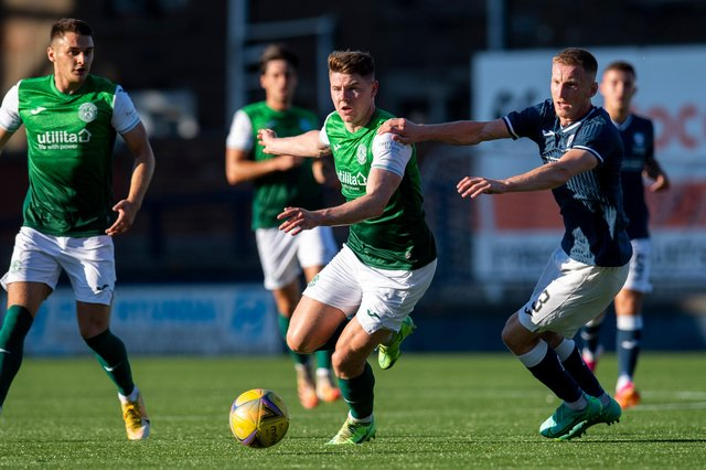 Hibs striker Kevin Nisbet looks to give Liam Dick of Raith Rovers the slip during Iain Davidson's testimonial at Stark's Park