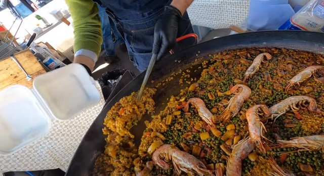 A portion of paella is served up from the Leith Walk pop-up venue. Picture: Ruairidh Mason
