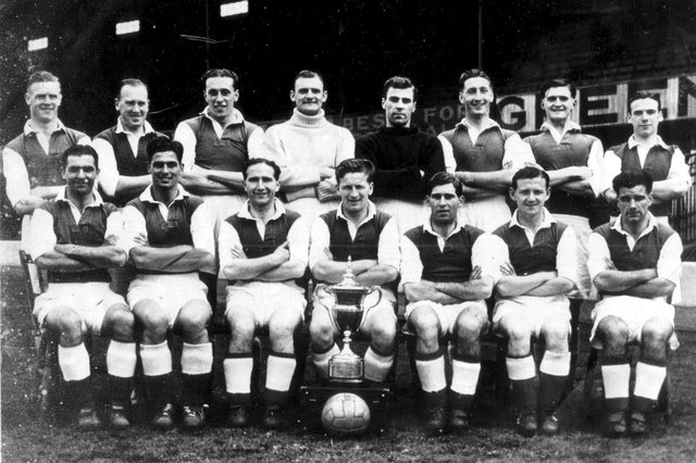 The Hibs team of 1947/48 - although Leslie Johnston is not pictured. Gordon Smith (front row, second left) Eddie Turnbull (front row, third right), Willie Ormond (front row, second right) and Lawrie Reilly (back row, extreme left) are all present