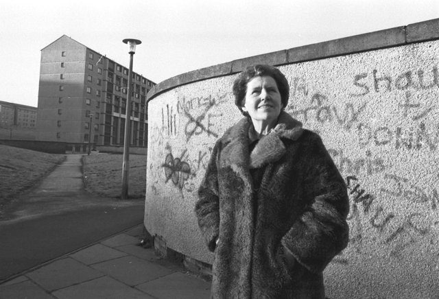 Dr Alice Coleman, author of 'Utopia on Trial' visiting Wester Hailes high-rise flats in Edinburgh, standing in front of a graffiti-covered wall in November 1986.