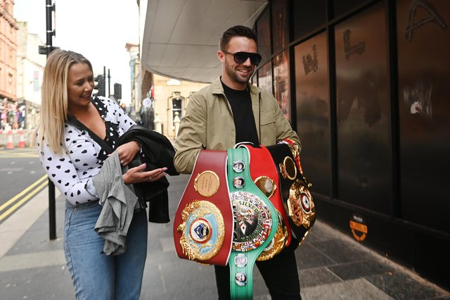 Josh Taylor, pictured with partner Danielle, wants a homecoming fight before heading back across the Atlantic. (Picture: John Devlin)