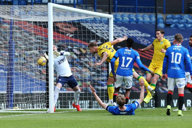 Hibs defender Ryan Porteous scores his disallowed goal against Rangers at Ibrox. (Photo by Ian MacNicol/Getty Images)