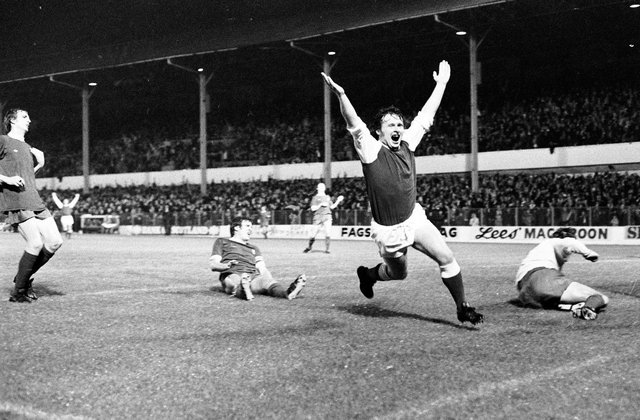Joe Harper wheels away after beating Ray Clemence with what turned out to be the winner against Liverpool in September 1975