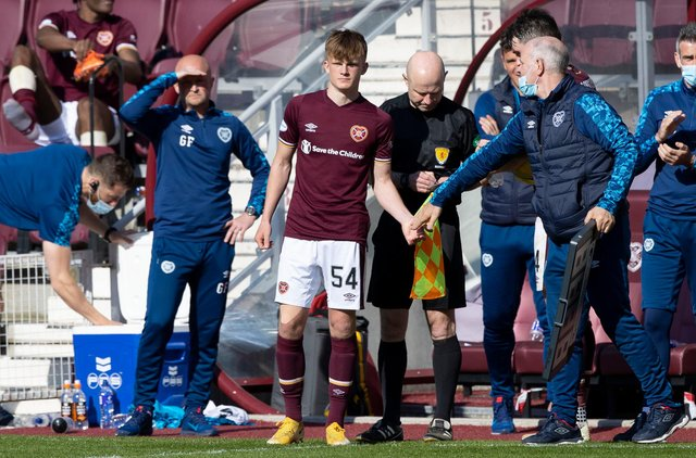 Finlay Pollock was handed his Hearts bow by Robbie Neilson after impressing. Picture: SNS