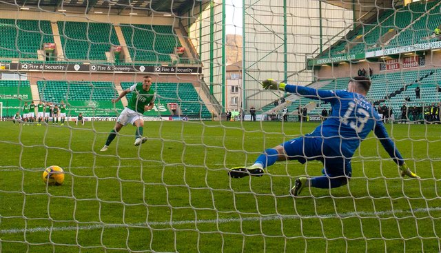 Ryan Porteous tucks away the winning penalty to send Hibs into the Scottish Cup semi-finals. Picture: SNS