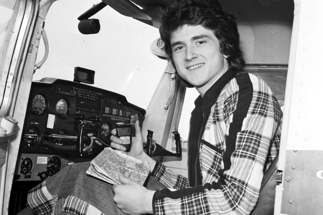 Les McKeown of the Bay City Rollers, dressed in the band's trademark tartan, takes a flying lesson at Turnhouse airport in April 1975