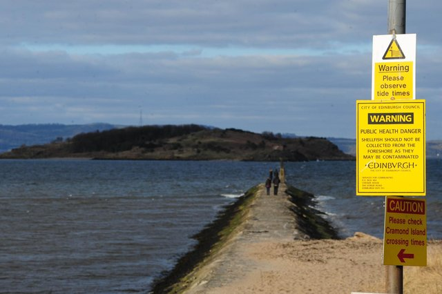 Warnings about the risk of being cut off by the tide are hard to miss on the causeway to Cramond Island (Picture: Ian Rutherford)