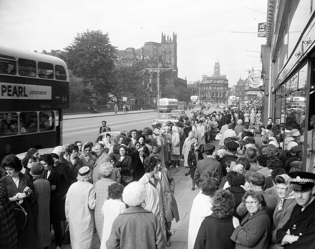 Hundreds of shoppers queue up on Princes Street for the annual sales in July 1963.