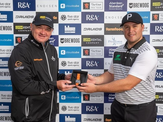 Paul Lawrie, who set up the Tartan Pro Tour, presents Neil Fenwick with a watch after one of his victories on the circuit last season. Picture: Kenny Smith