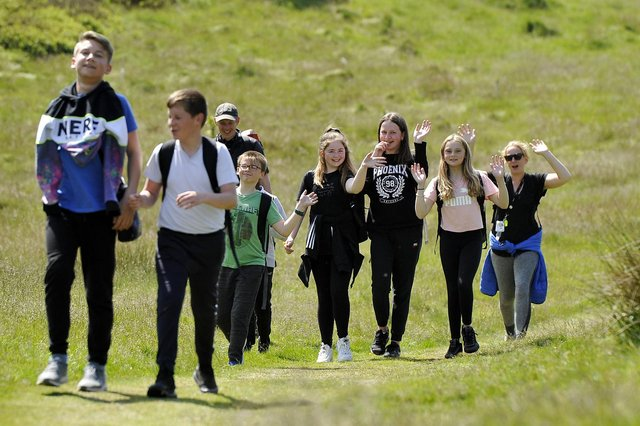 Pupils take part in a variety of activities: hillwalking, climbing wall, crate- stack, nightline and low ropes course. Sighthill Primary P7 pupils taking part in hillwalking.
