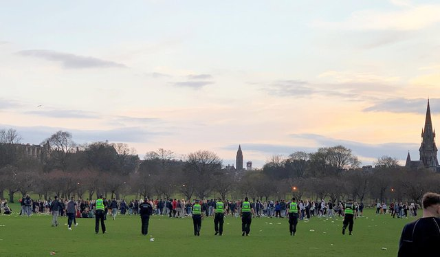 Huge crowds of boozy teenagers gathered at the Meadows in Edinburgh were dispersed by police (Picture: Anna Koslerova/SWNS.com)
