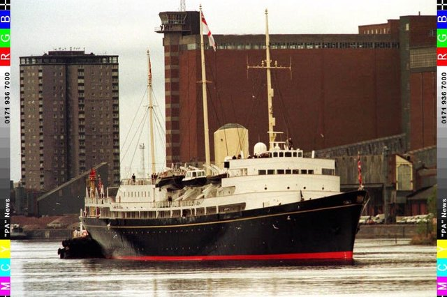 The Royal Yacht Britannia makes her way up the River Clyde, Glasgow where she was built, during her farewell voyage  around the British Isles.