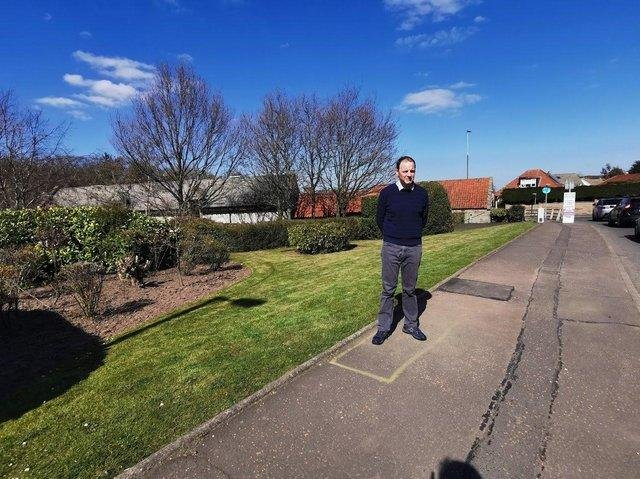 Councillor Scott Arthur at site where the mast is meant to go
