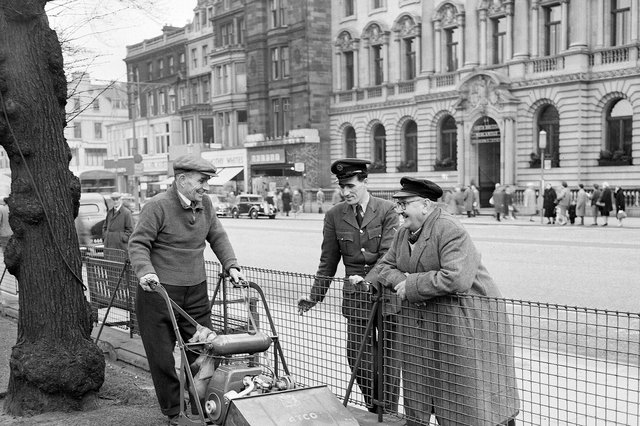 East Princes Street Gardens - Grass given first cut of year by Jimmy Hunt watched by Raymond Collins and taxi driver James Love in 1961