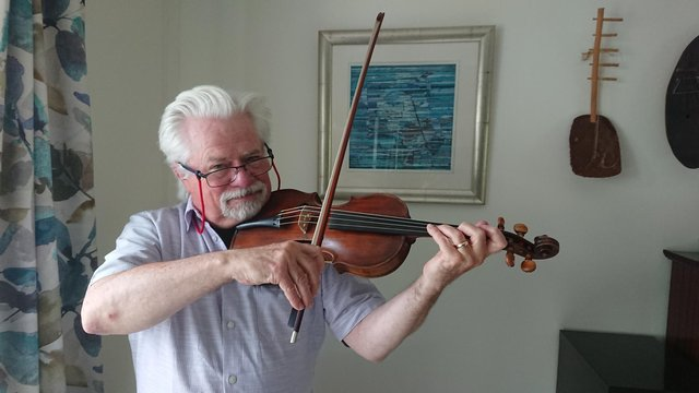 Aberdour man Frank Glynn is delighted to have his newly restored fiddle back after it was repaired by David Rattray. The fiddle once belonged to Scottish amateur musician George Thomson.