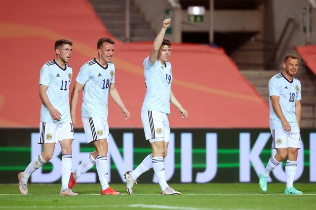 Kevin Nisbet of Scotland celebrates after scoring his  side's second goal during the international friendly match between Netherlands and Scotland at Estadio Algarve on June 02, 2021 in Faro, Portugal. (Photo by Fran Santiago/Getty Images)