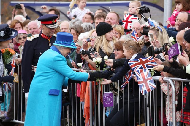 Queen Elizabeth greets well-wishers in Newtongrange on the day she became Britain's longest reigning monarch in 2015 (Picture: Andrew Milligan/WPA pool/Getty Images)