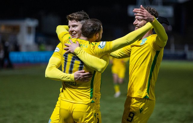 Martin Boyle celebrates scoring the third goal with Kevin Nisbet and Christian Doidge