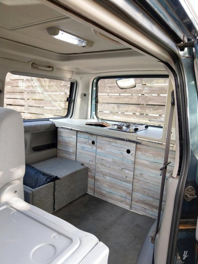The interior of the van with bed folded away.