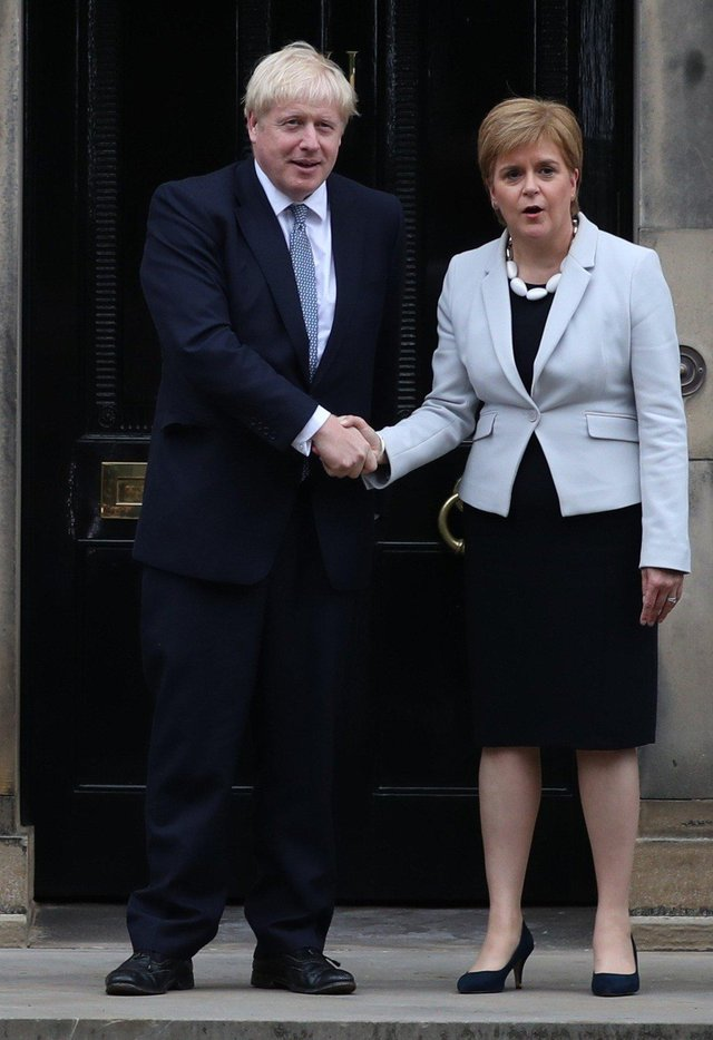 Scotland's First Minister Nicola Sturgeon welcomes Prime Minister Boris Johnson outside Bute House in Edinburgh ahead of their meeting. PRESS ASSOCIATION Photo. Picture date: Monday July 29, 2019. See PA story POLITICS Brexit Scotland. Photo credit should read: Jane Barlow/PA Wire