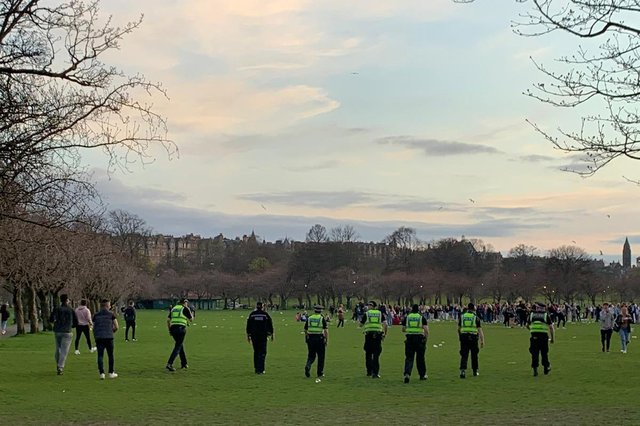 Police can seen approaching the crowd in a line formation as illegal gatherings continue in the meadows (Photo: Anna Koslerova).