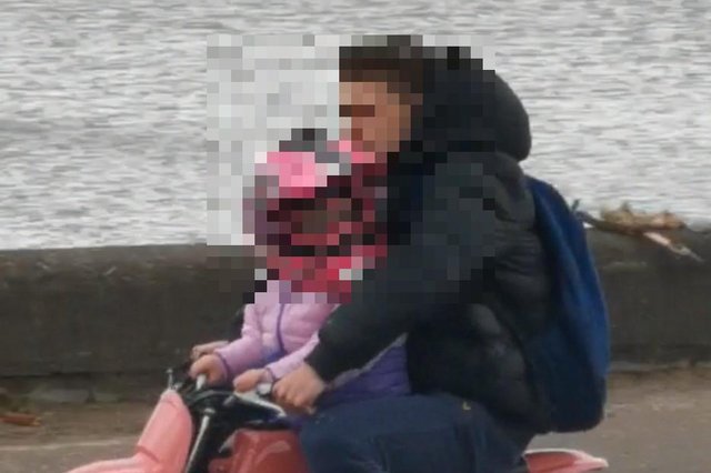 A man and a young child appeared to be riding a small pink motorbike alongside four other bikers in Silverknowes on Sunday afternoon.