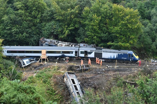 The front section of the High Speed Train in the Carmont crash is in the bottom right of the picture, partially concealed by undergrowth. Picture: John Devlin