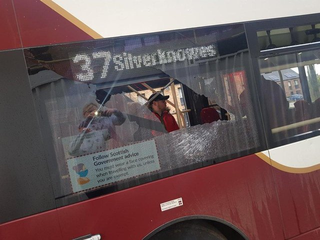 Targeted: Thugs smashed this bus window