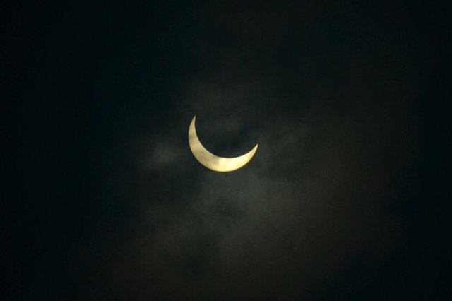 The moon partially covers the sun during an annular solar eclipse as seen from Siliguri on June 21, 2020. (Photo by Diptendu DUTTA / AFP).