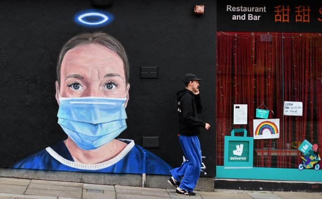 NHS staff should be treated with the respect displayed by graffiti artist @akse_p19 in this piece in Manchester last year  (Picture: Paul Ellis/AFP via Getty Images)