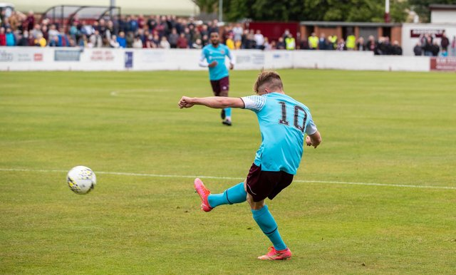 Finlay Pollock scores Hearts' first goal against Linlithgow Rose.