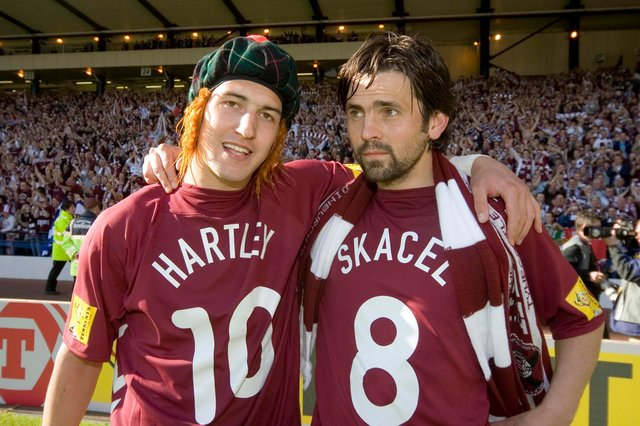 Rudi Skacel (left) celebrates Hearts' Scottish Cup win with team-mate Paul Hartley, who was red carded in the closing stages of extra time. Picture: SNS