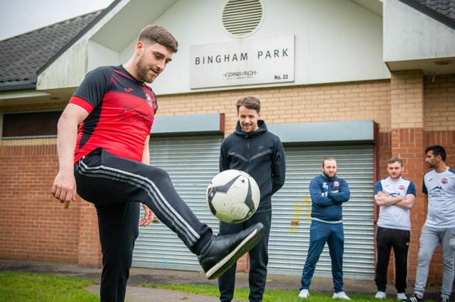 Scotland and Dundee United footballer and local lad, Marc McNulty (dressed all in black), with members of the Bingham Athletic team.
