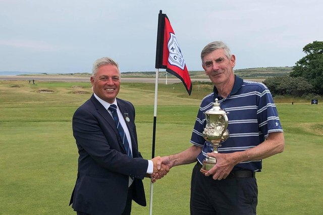 After facing each other in the final, Bob Humble, right, receives the Kilspindie club championship trophy from captain Chris Stirling. Picture: Kilspindie Golf Club