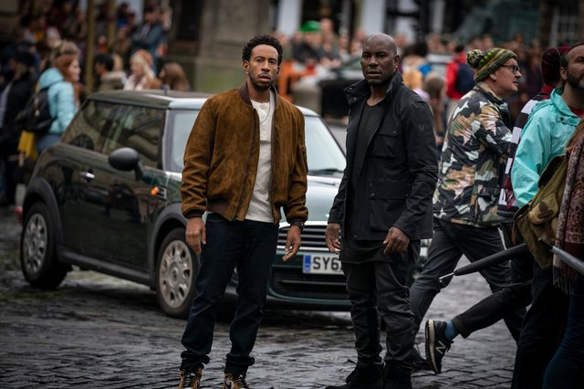 """Tej (Chris """"Ludacris"""" Bridges) and Roman (Tyrese Gibson) film F9, directed by Justin Lin, on the Royal Mile"""