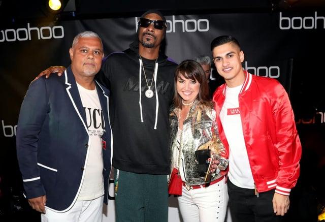 Mahmud Kamani (left) with Snoop Dogg, co-founder Carol Kane and son Samir Kamani (Getty Images)