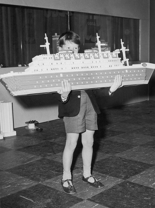 Ian Pemberton, seven, with a Lego model liner that was part of a Lego city built in London's Selfridges in 1962 (Picture: Kent Gavin/Keystone/Hulton Archive/Getty Images)