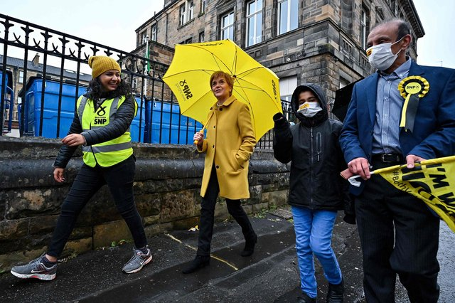 Nicola Sturgeon and candidate Roza Salih (L)  at Annette Street school polling station in Glasgow