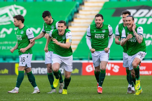 The Hibs players celebrate winning the penalty shoot-out against Motherwell