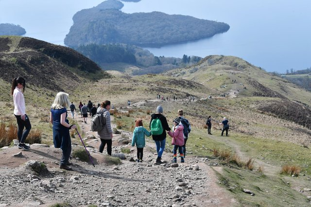 Walkers take to the hills overlooking Loch Lomond as restrictions ease.