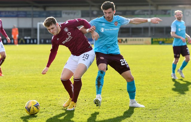 ARBROATH, SCOTLAND - MARCH 20: Arbroath's Jack Hamilton and Hearts' Mihai Popescu in action during the Scottish Championship match between Arbroath and Heart of Midlothian at Gayfield Park on March 20, 2021, in Arbroath, Scotland. (Photo by Sammy Turner / SNS Group)