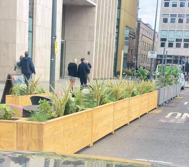 The planters are situated outside The Ivy on St Andrews Square