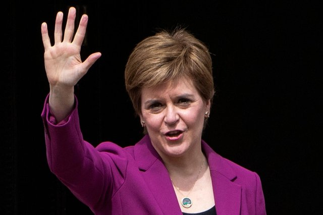 Nicola Sturgeon waves as she returns to Bute House on Sunday