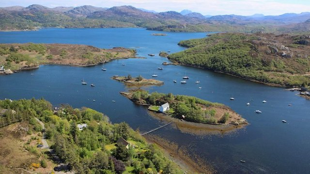 The Dry Island is situated in the Gair Loch, surrounded by incredible Scottish scenery.